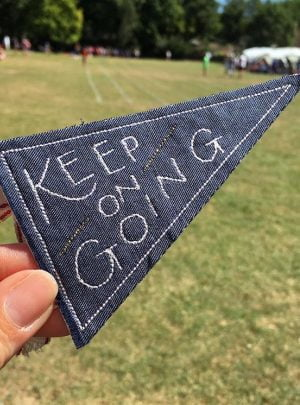 Keep on going pennant flag