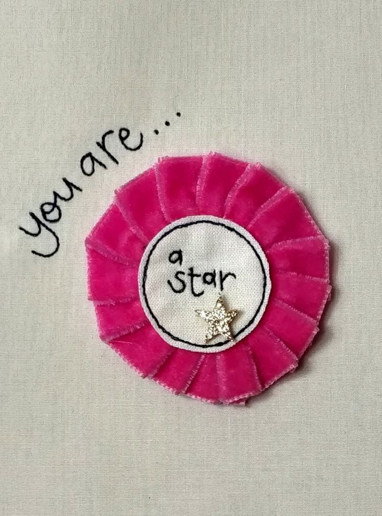 You are a star rosette badge