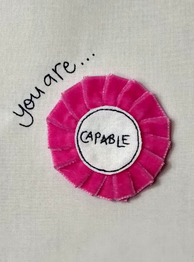 You are capable rosette badge