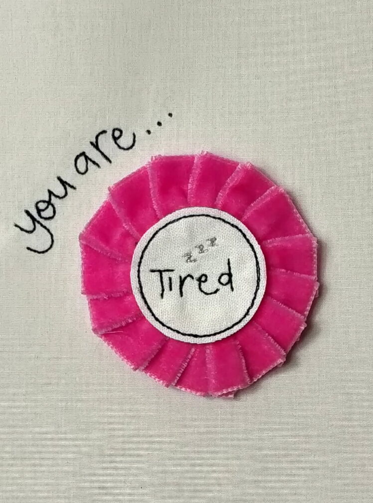 You are tired rosette badge