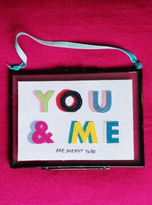 You and Me embroidered rainbow text picture